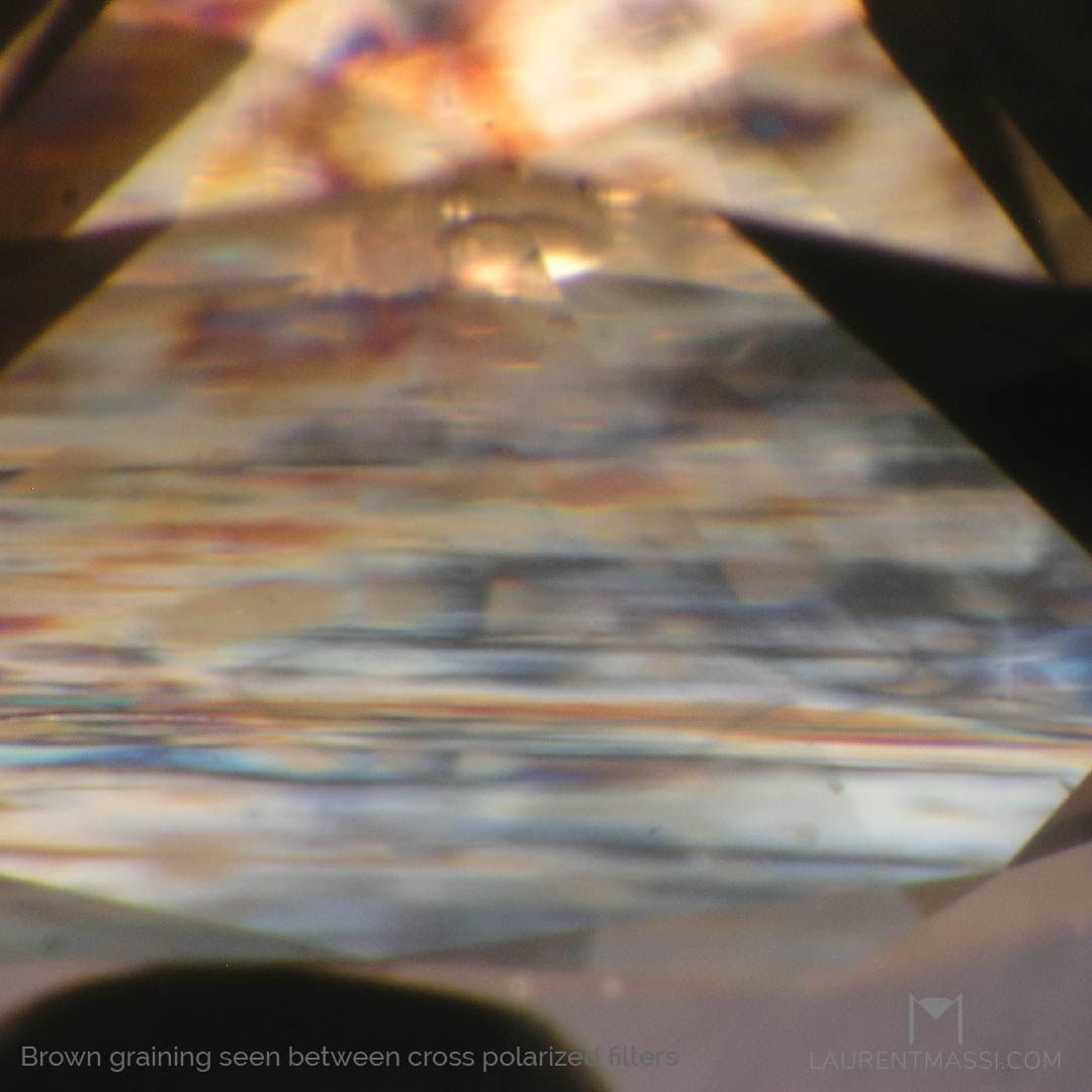 Photomicrography of a brown graining in a natural diamond seen under cross polarized filters